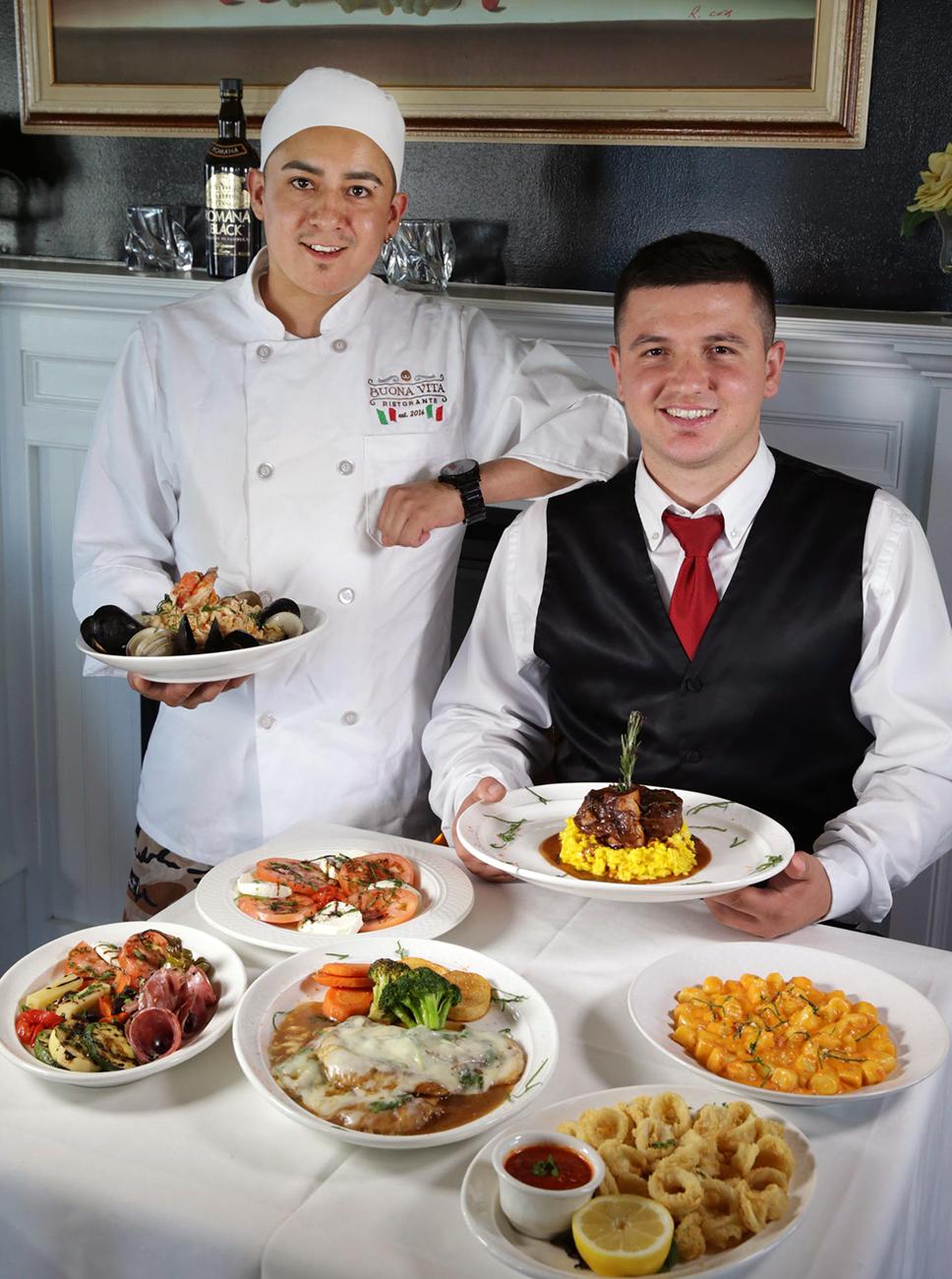 Chef Jose Ramirez, left, and server Mario Kupa, both of Philadelphia, present signature dishes